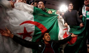 People celebrate on the streets after Algeria's President Abdelaziz Bouteflika resigned
