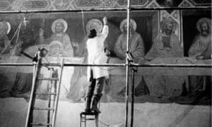 A restorer working on a fresco.