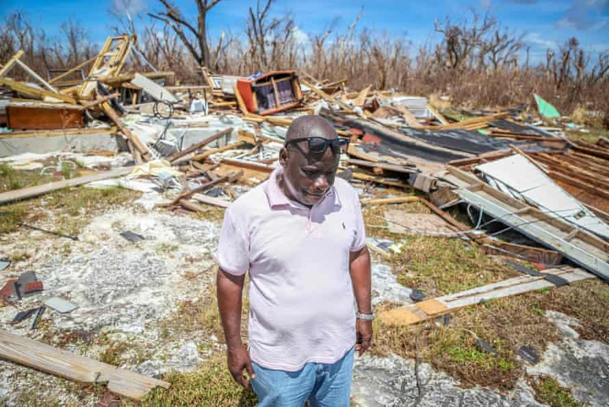 Bursel Pinder stands among the rubble of his destroyed home in High Rock, Bahamas, in September 2019.