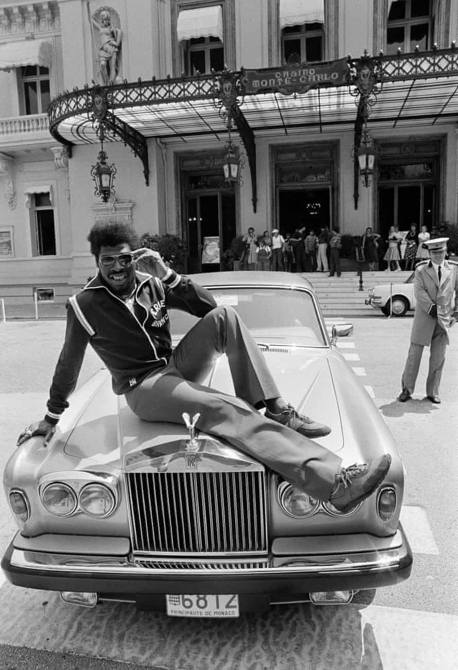 Spinks poses with a Rolls Royce in Monaco in 1979, a year after losing his title to Ali.