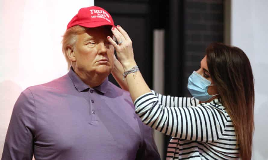 A member of the Madame Tussauds studio team adjusts a wax figure of Donald Trump in London on 4 November 2020.