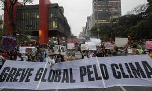 """Demonstrators hold a """"Global strike for climate"""" banner during a protest on climate change in São Paulo, Brazil."""