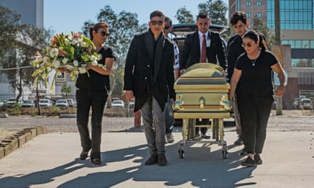 Relatives of Marbella Ibarra participate in her funeral in the city of Tijuana, Mexico, on Thursday.