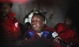 EFF leader Julius Malema speaks to journalists outside parliament.