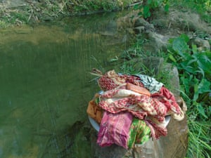 Stack of menstrual pads by a stream in Sindhuli, Nepal