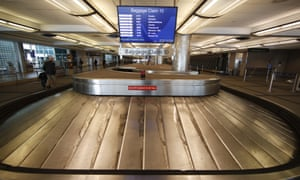 An empty baggage carousel spins in Denver International airport during the coronavirus pandemic.