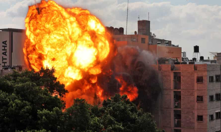 Fire engulfs a building in Gaza following an Israeli airstrike on 13 May 2021