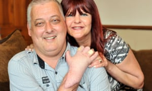 Britain's first ever hand transplant patient Mark Cahill with his wife Sylvia at home in Halifax