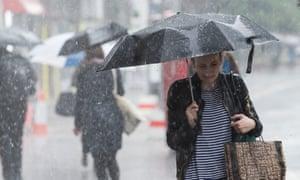 A woman shopping in rain