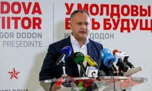 Moldova presidential candidate Igor Dodon speaks to the media