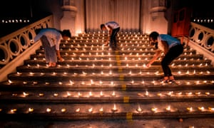 Mourners light candles during a vigil in memory of the bomb blast victims in Colombo.