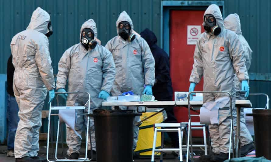 Forensic police officers wearing hazmat suits examine a vehicle believed to belong to Sergei Skripal