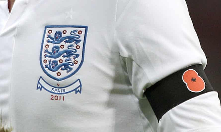 England wear armbands bearing poppies against Spain in 2011