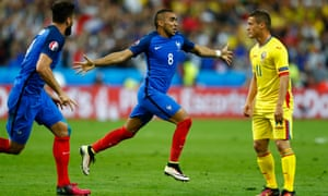Dimitri Payet celebrates after scoring a late winner for France.