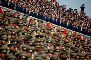 A soldier films North Korean soldiers, officers and officials attending a parade marking the 105th birth anniversary of Kim Il Sung in Pyongyang.