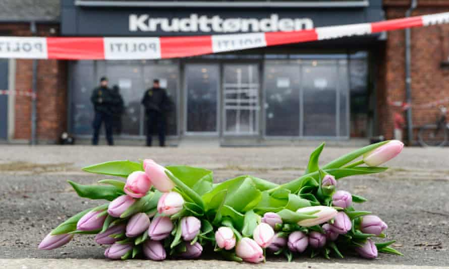 Flowers are placed at the site of a shooting in Copenhagen.