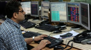 A stock brokerage firm in Mumbai, India, today, where shares rose by 1% today.