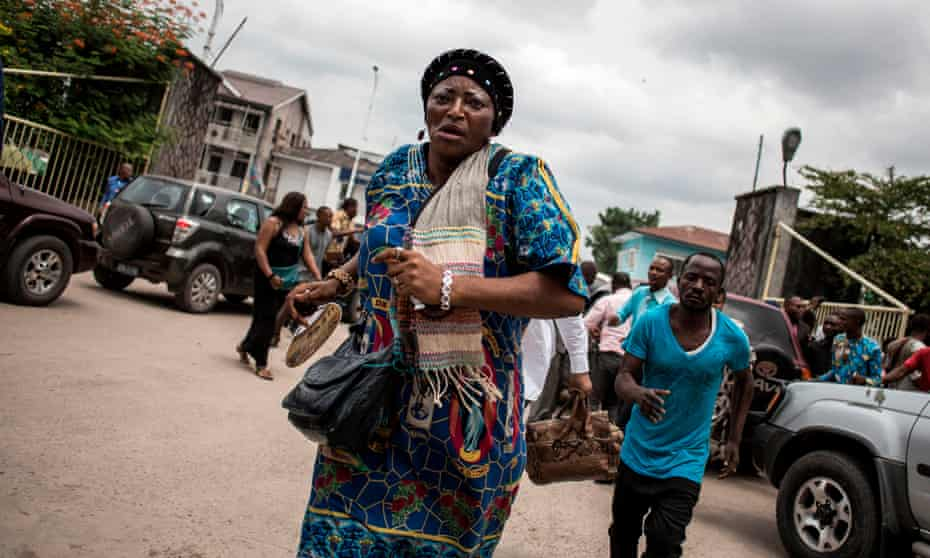 Police fire warning shots to disperse a crowd leaving a cathedral in Kinshasa, the Democratic Republic of the Congo, after a mass commemorating victims of a crackdown on marches last month calling for the removal of President Joseph Kabila, January 2018