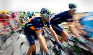 Movistar team rider Alejandro Valverde (L) of Spain is all ablur.