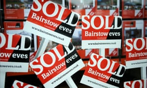 A montage of 'Sold' signs in a Bairstow Eves estate agent