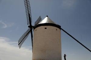 La Mancha, SpainA tourist stays in the shade as he visits La Mancha windmills