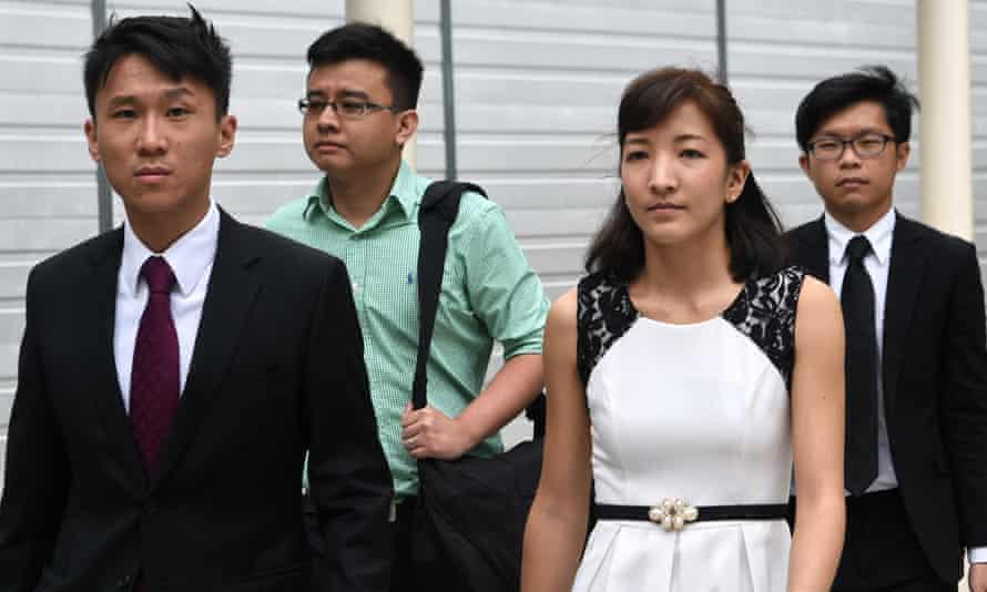 Ai Takagi and her husband, Yang Kaiheng, leave court