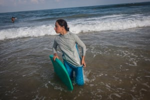 Surfer, Sabah Abu Ghanem ,14 and her sister surf early in the morning outside of Gaza city. The sisters place first in many competitions inside the strip, but have never left the Gaza Strip to compete. For many Gazans the sea is the only place they can be without being reminded of their isolation
