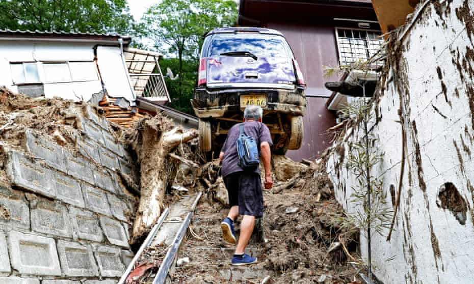 Tadashi Tsuboi, 83, returns to what is left of his home after Typhoon Jongdari passed through the area in Hiroshima, Japan