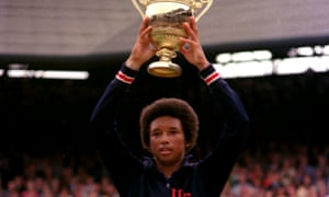 Arthur Ashe celebrates his Wimbledon triumph in 1975.