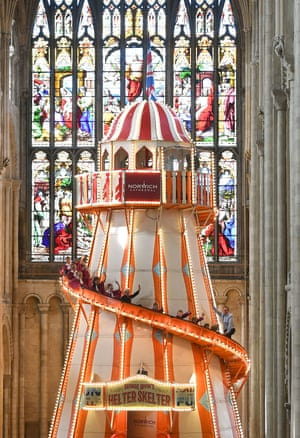 Choristers from Norwich Cathedral take a ride on the helter skelter