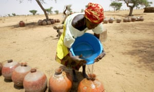 A woman collects water from a well at El Kolta village, near Maradi, south-eastern Niger.