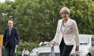 Theresa May arrives with her husband Philip to cast her vote.