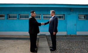 Kim Jong-un and Moon Jae-in shake hands at the border