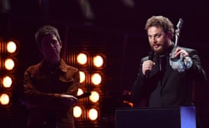 Duncan Jones accepts an award on behalf of his father David Bowie