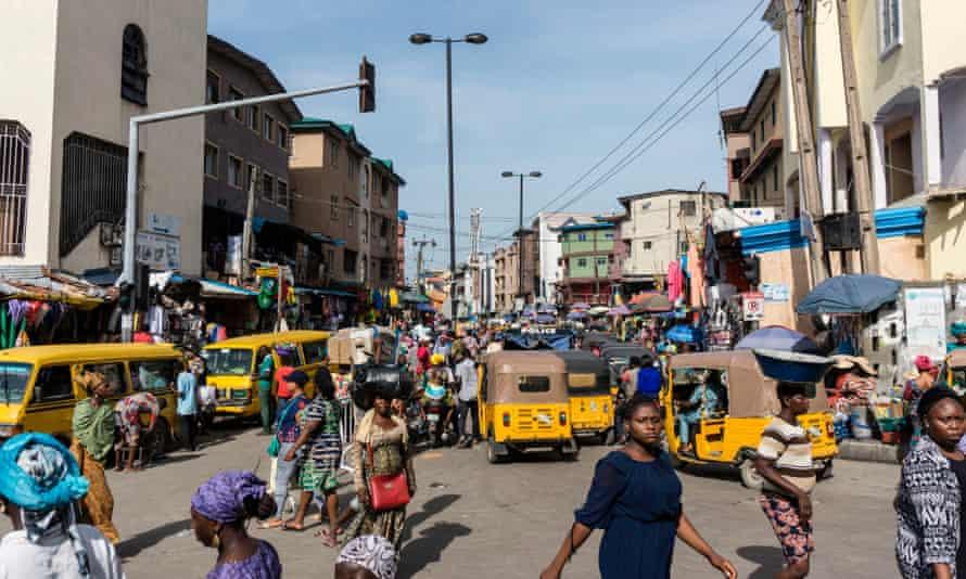 People walk through Balogun market in Lagos.