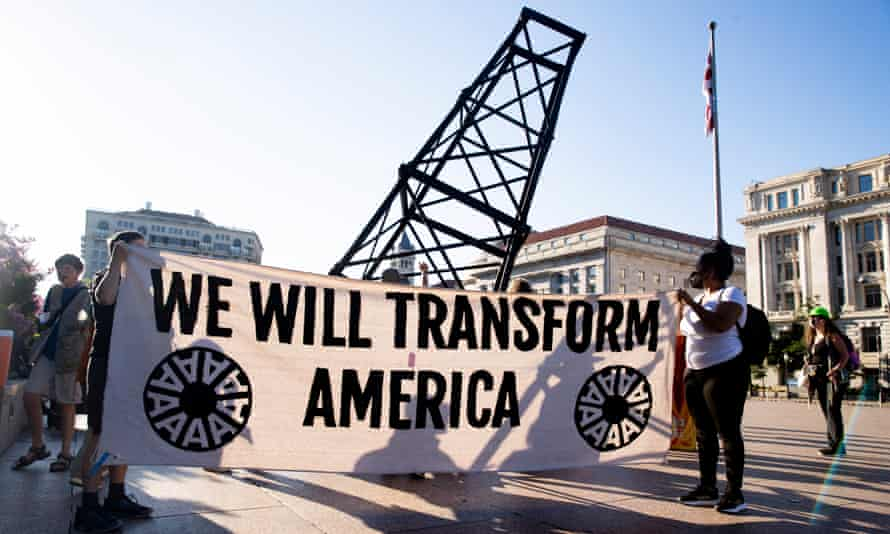 Climate activists march outside the White House to protest against fossil fuel use and to urge Joe Biden to prioritize clean energy climate policy.