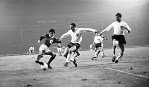 Best in action for Northern Ireland against England at Wembley in November 1965, causing problems for the defenders George Cohen, left, and Jack Charlton
