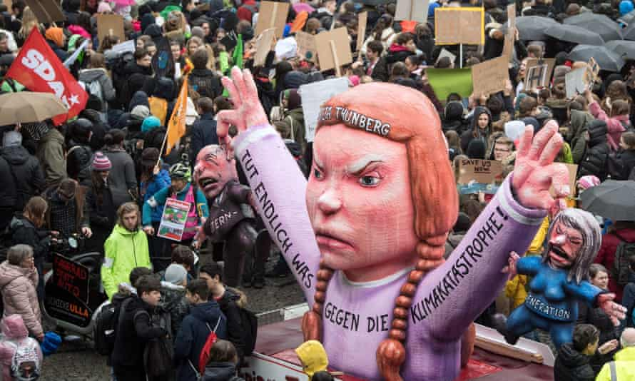 In Germany youths demonstrate with banners and placards and a figure depicting young Swedish climate activist Greta Thunberg
