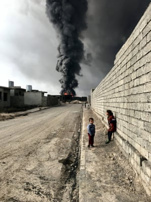 Sebastiano Tomada of New York City, USA took the grand prize and was photographer of the year for a shot of children in Qayyarah, Iraq, near fire and smoke billowing from oil wells set ablaze by Islamic State militants