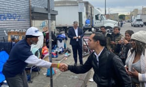 Julian Castro speaks with homeless man on Skid Row in Los Angeles.