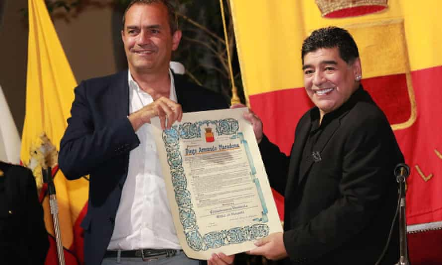 Maradona, right, receives the honorary citizenship of Naples from Luigi De Magistris in 2017