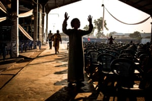A worshipper prays at the Christian ministry of spiritual combat in Kinshasa.