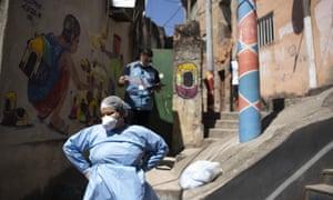 A city health worker takes a rest during a coronavirus test program that aims to administer 20,000 tests in Rio de Janeiro's poor neighbourhoods, at Morro da Providencia favela, Rio de Janeiro, Brazil 3 September, 2020.
