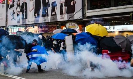Riot police fire teargas at the protesters on Nathan Road during the demonstration in Hong Kong on Sunday.