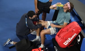 Tsitsipas receives treatment after three-and-a-half sets of hard running.