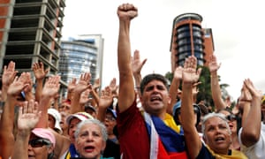 Opposition supporters react during a rally against President Nicolás Maduro's government in Caracas on Wednesday.