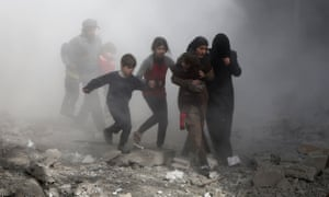 Syrian civlians flee from air strikes in the rebel-held town of Jisreen, in the besieged eastern Ghouta region on the outskirts of the capital Damascus.