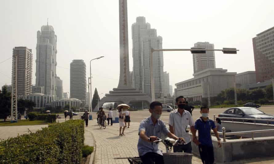 People are seen on Ryomyong Street in Pyongyang, North Korea in July 2020.