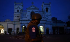 A security official stands guard outside St Anthony's shrine in Colombo.