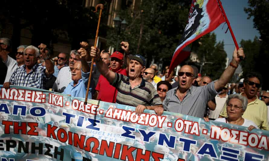 Greek pensioners shout slogans during a demonstration against planned pension cuts in Athens in October.